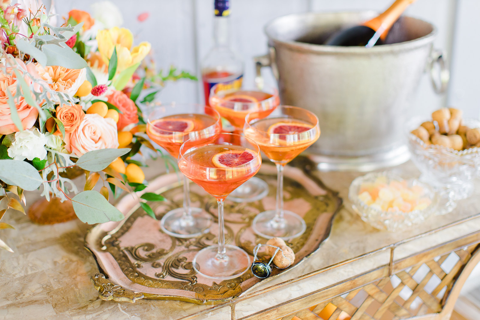 citrus inspired cocktails on vintage silver tray