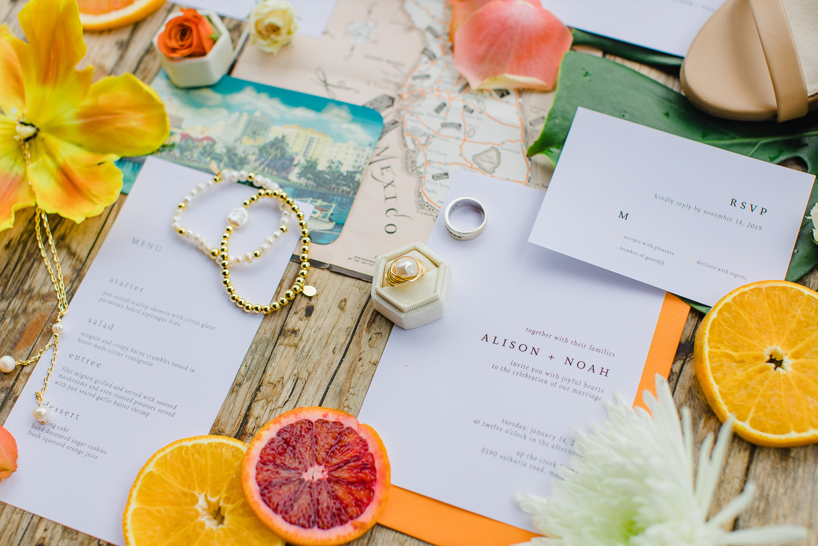 Old Florida inspired wedding invitation suite on rustic wood