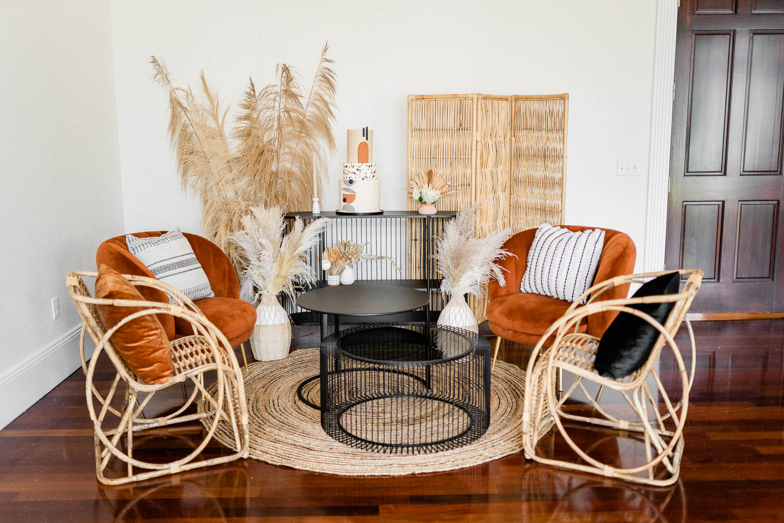 Boho inspired wedding lounge area with black and burnt orange chairs