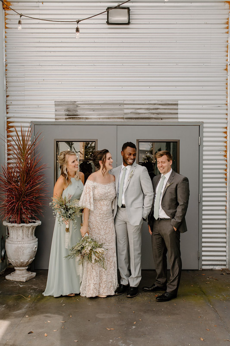 Couple with bridesmaid and best man for vow renewal