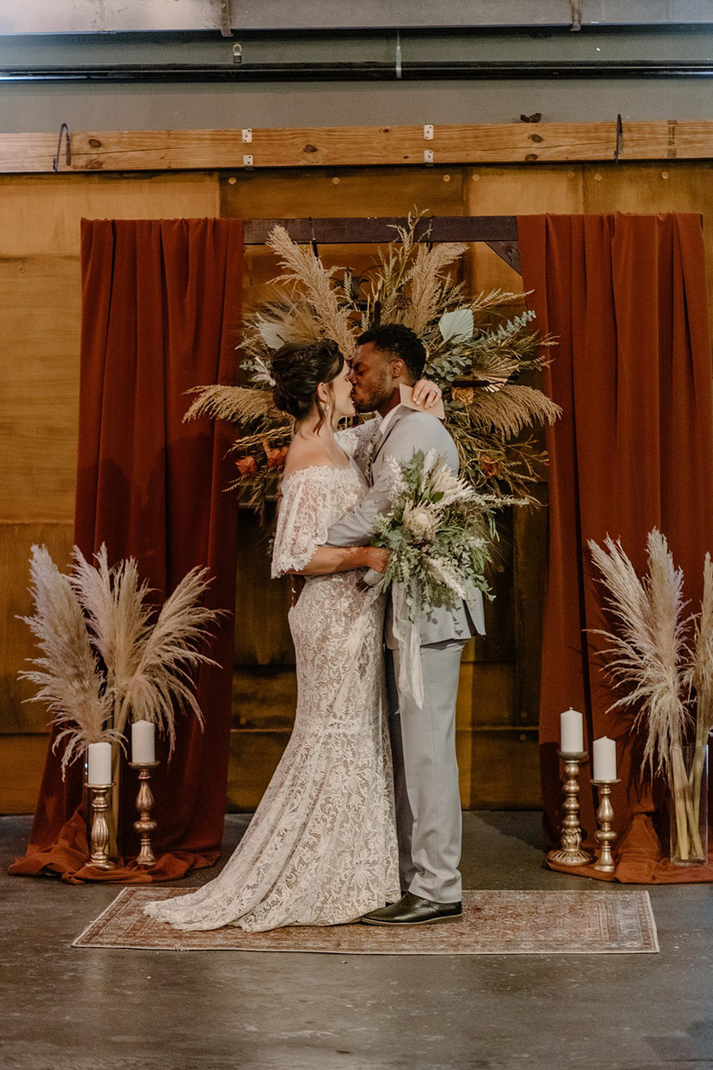 bride and groom kissing after vow renewal ceremony