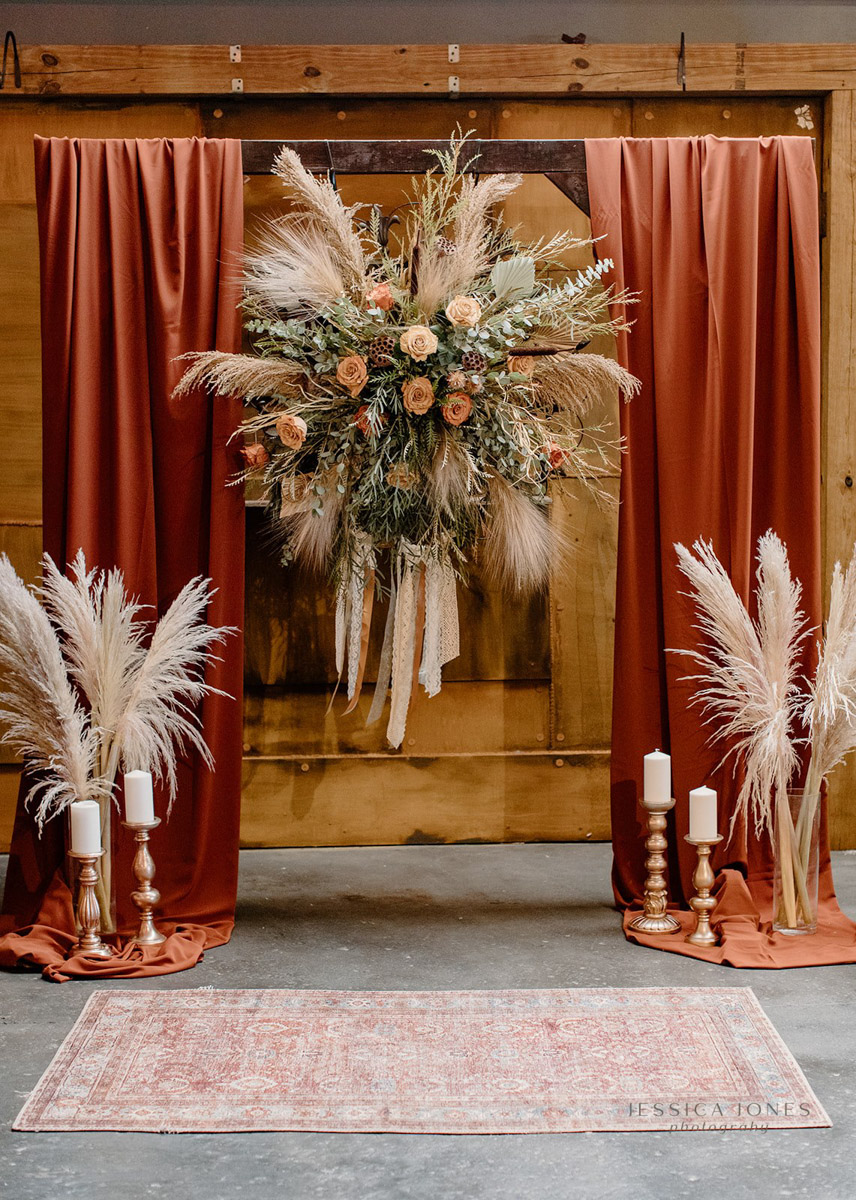 Large wedding ceremony floral piece with pampas grass and candles
