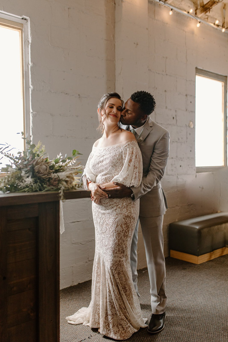 Groom kissing bride's cheek for vow renewal