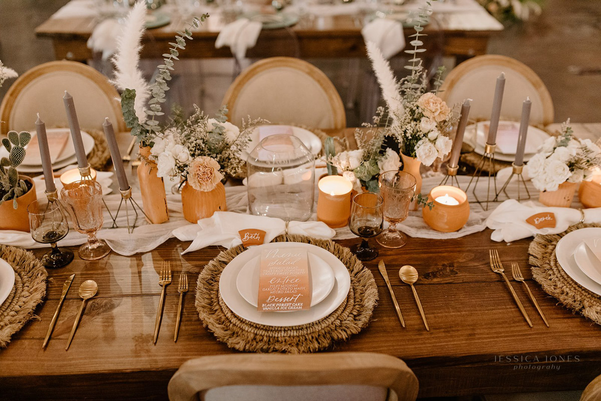 Terra cotta wedding reception table with candles
