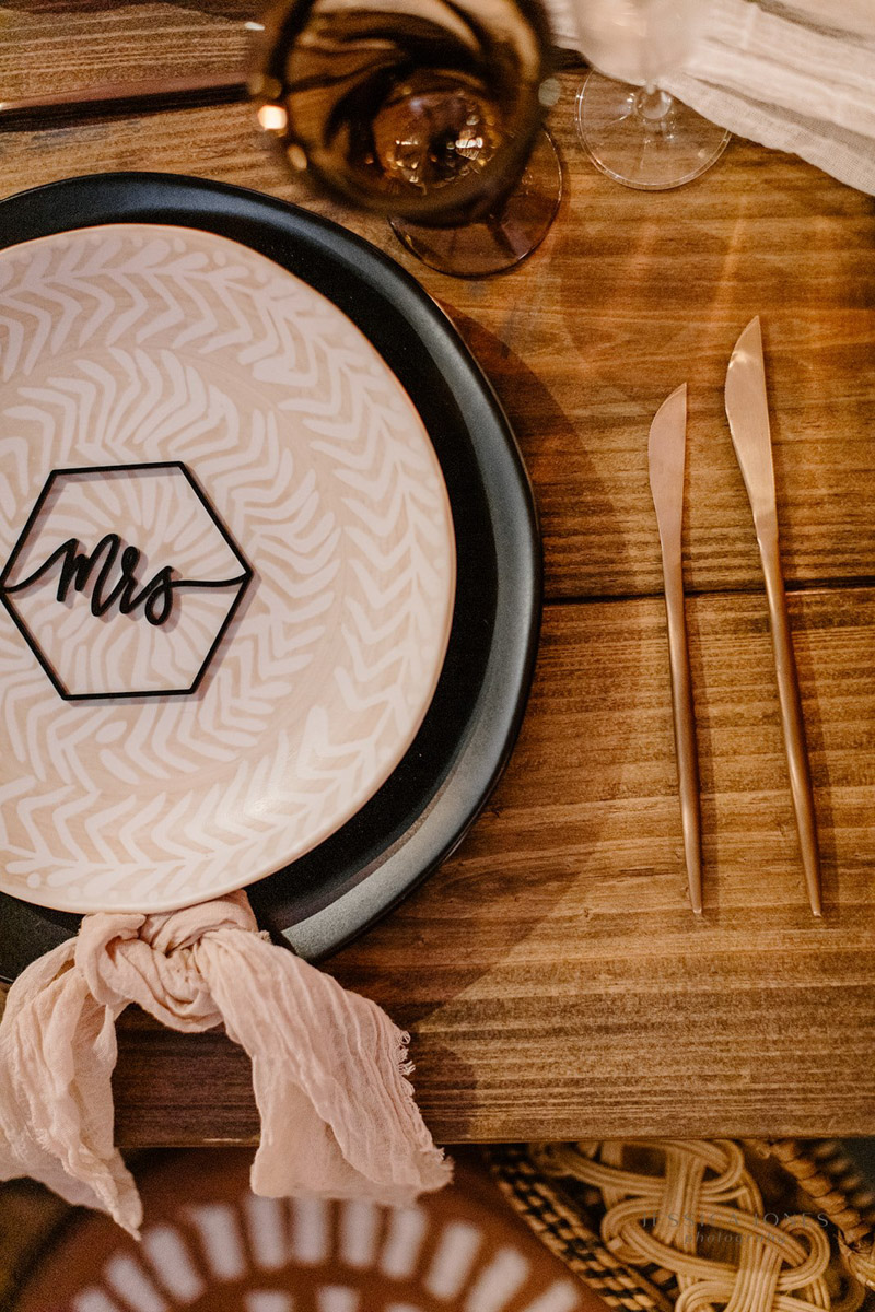 sweetheart table setting with black Mrs. placecard and black charger