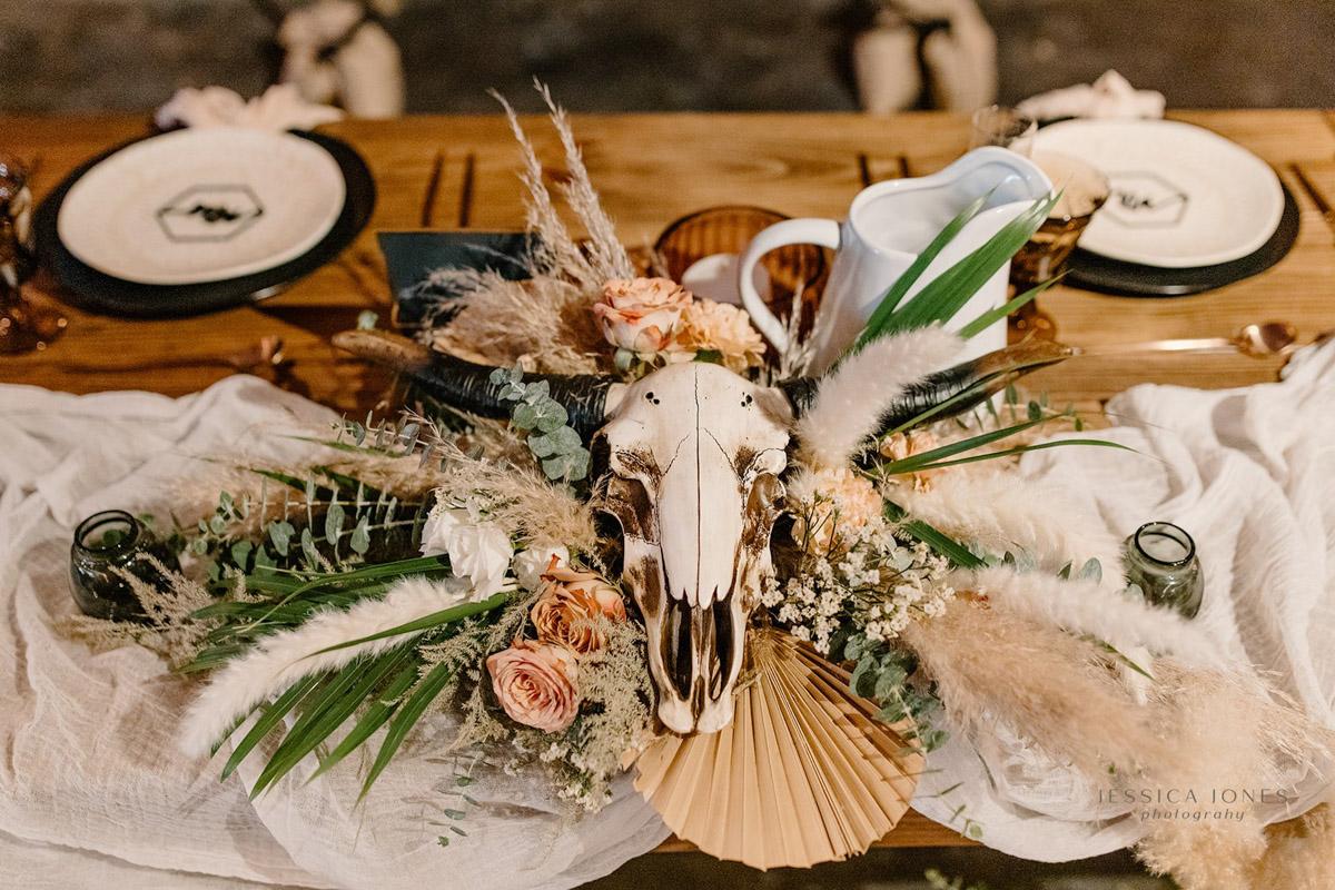 desert boho floral centerpiece on sweetheart table