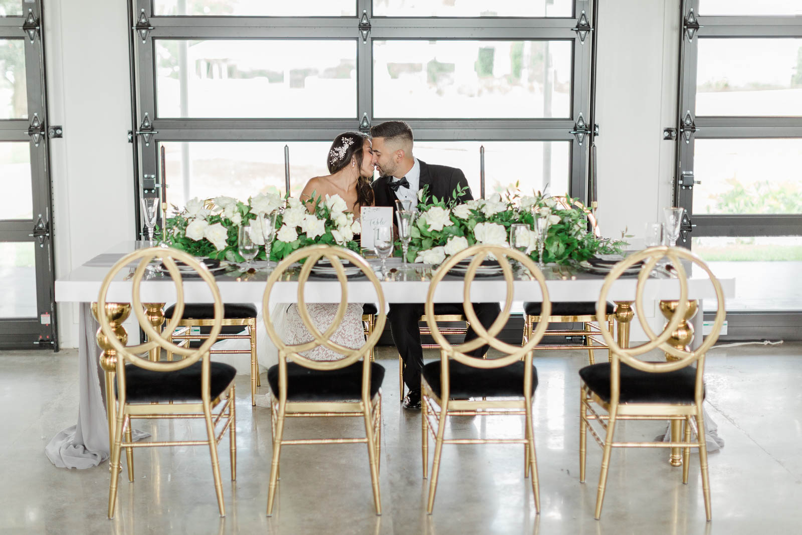 Bride and groom sitting at reception table