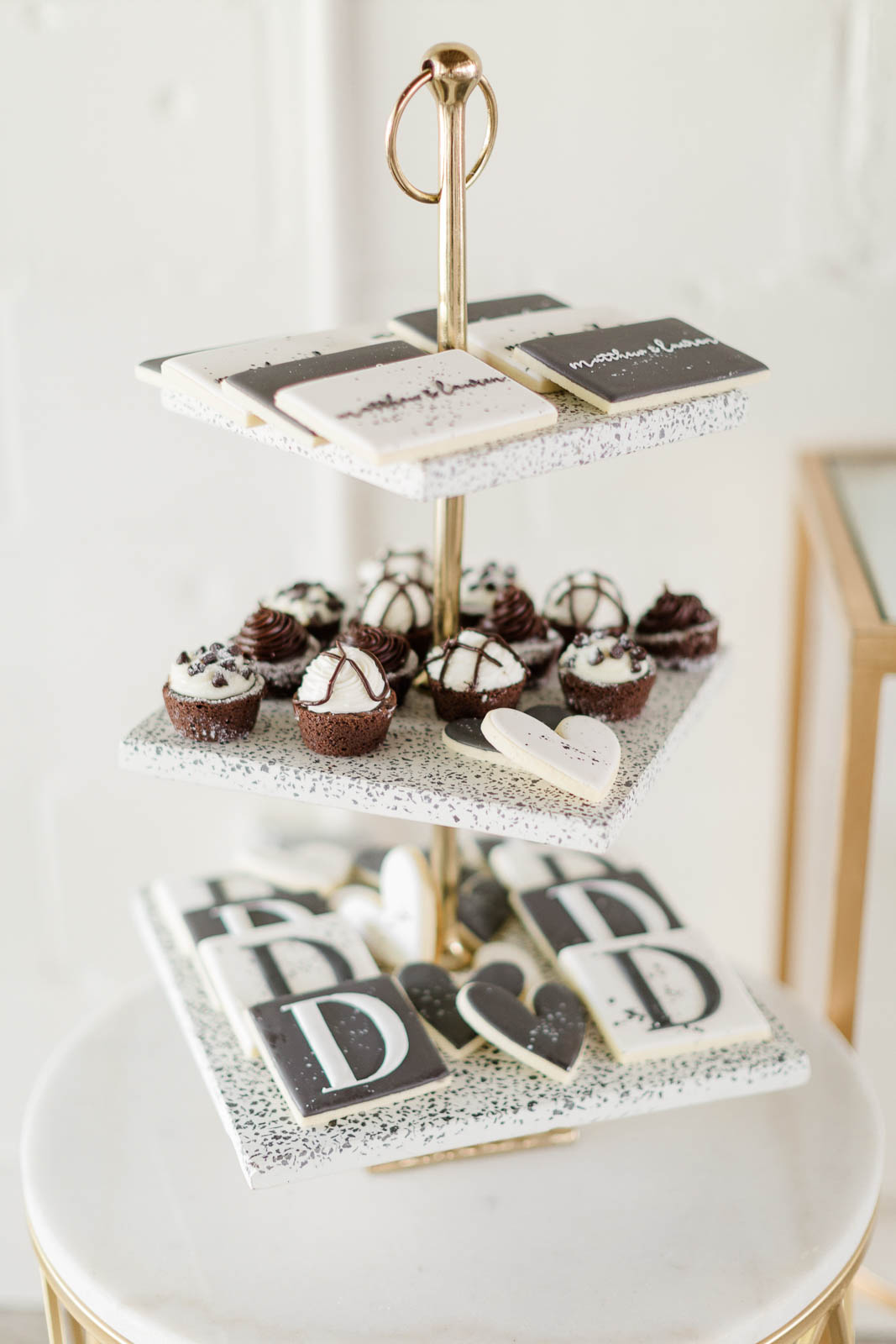 Black and white wedding cookies on three tiered stand