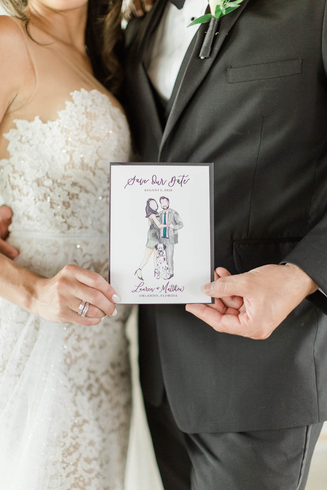 Bride and groom holding faceless portrait save the dates for wedding