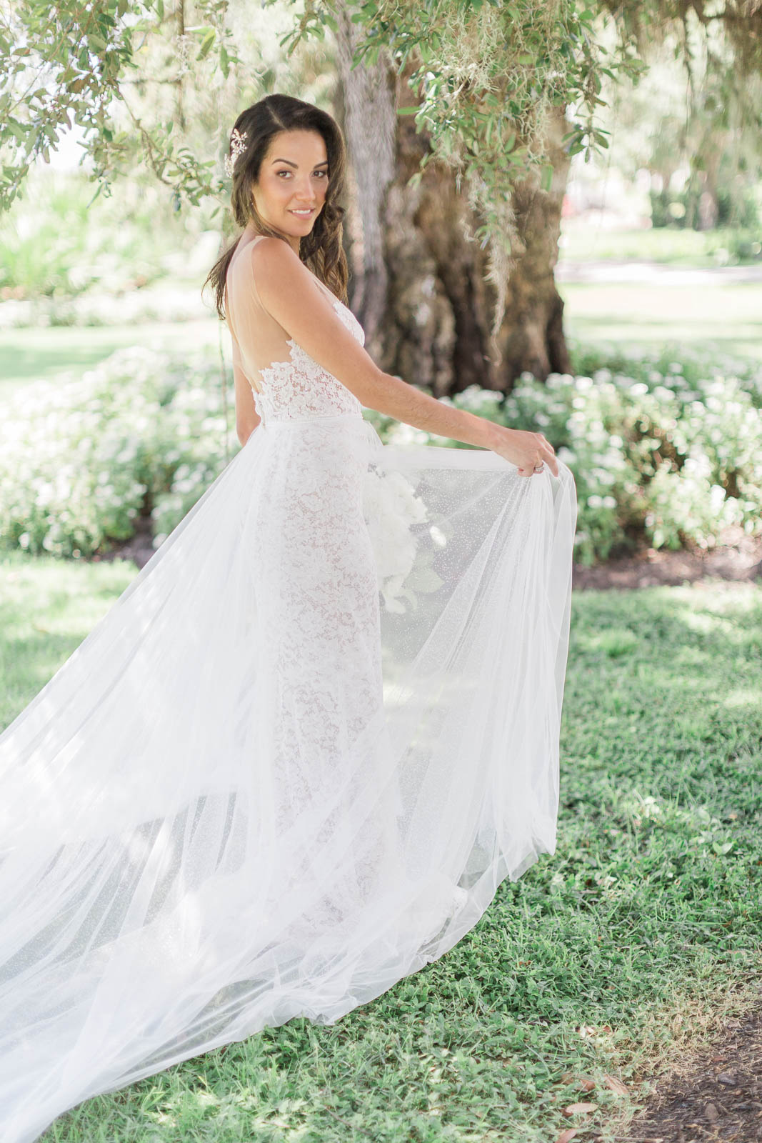 Bride in bridal gown with sheer overlay