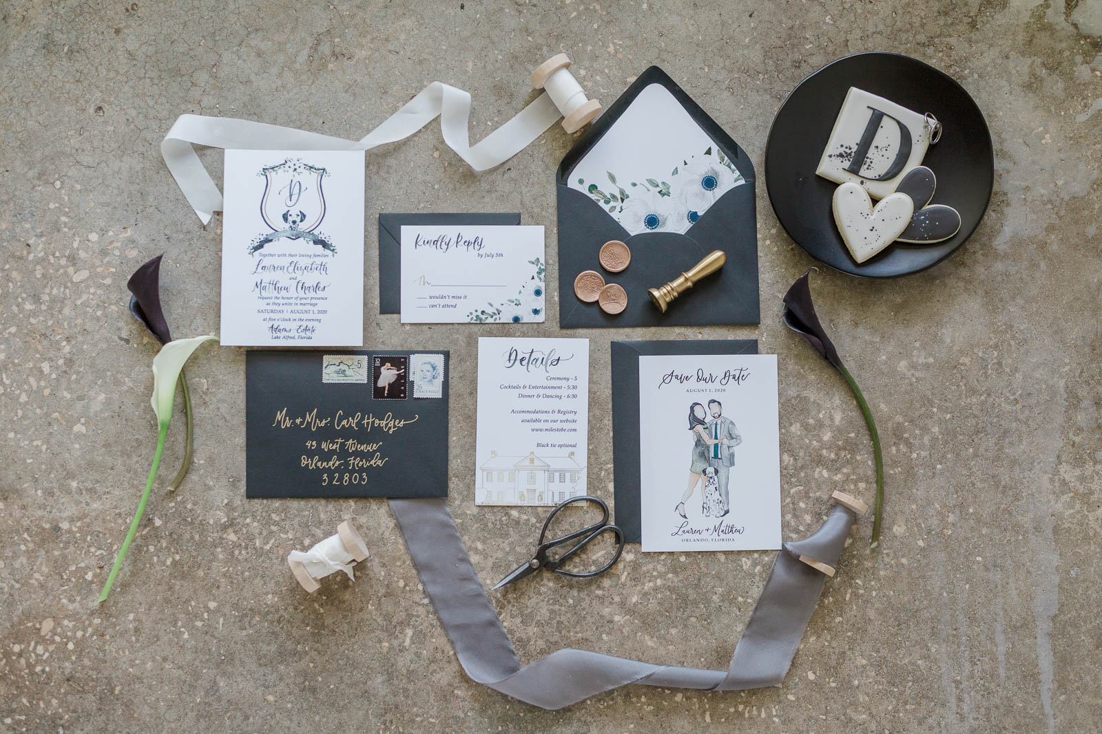 Black and white wedding invitation suite on cement